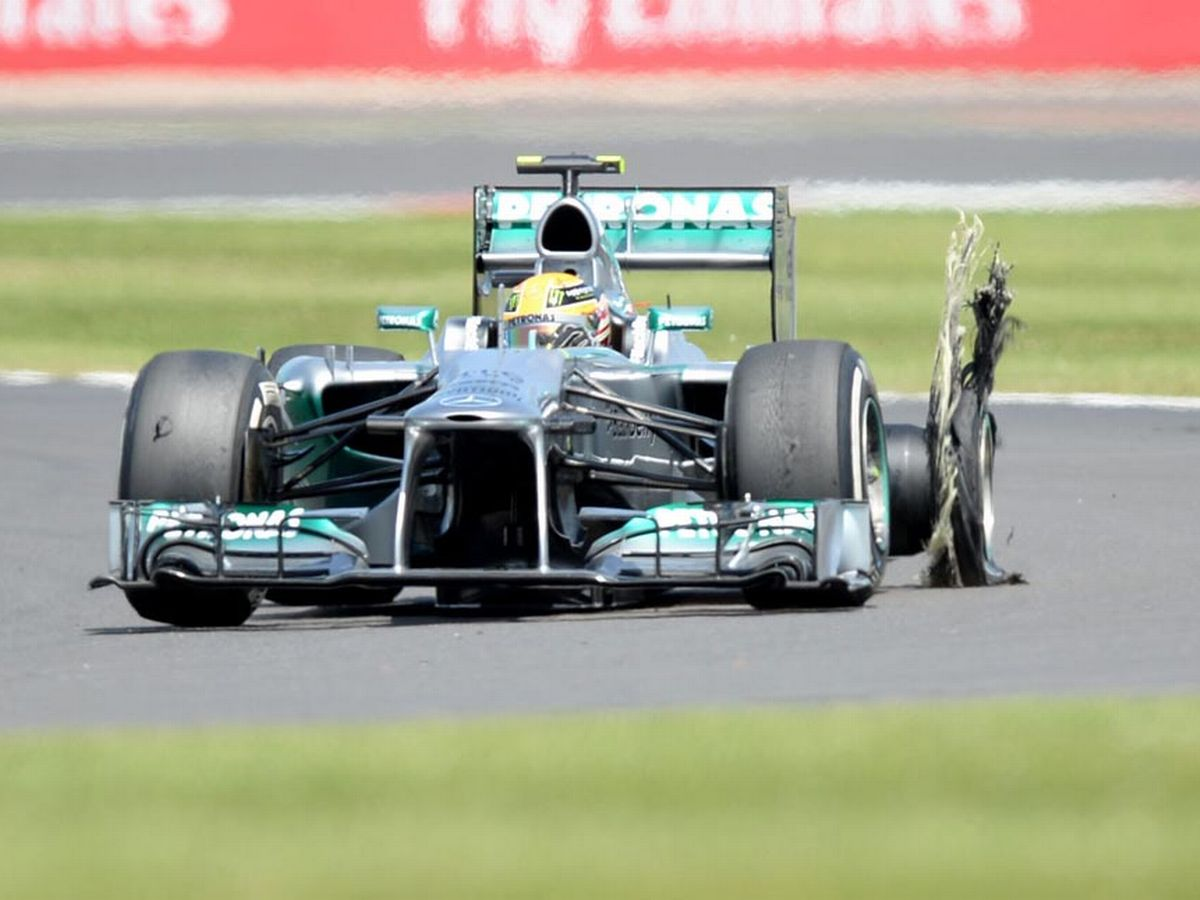 Lewis-Hamilton-with-a-burst-tyre.jpg